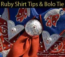 Custom made ruby shirt tips and bolo tie.